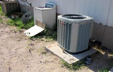 Stolen AC unit after it was installed at the rental property By Jennifer Thomas