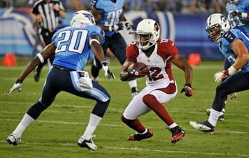 NASHVILLE, TN - AUGUST 23:  Andre Roberts #12 of the Arizona Cardinals runs toward Alterraun Verner #20 of the Tennessee Titans at LP Field on August 23, 2012 in Nashville, Tennessee.  (Photo by Frederick Breedon/Getty Images) By Frederick Breedon