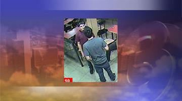 Police are looking for a suspect (right) and a person of interest in an aggravated assault outside a Jack in the Box restaurant. By Jennifer Thomas