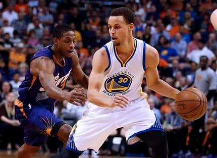 Golden State Warriors guard Stephen Curry (30) shields the ball from Phoenix Suns guard Brandon Knight in the second quarter during an NBA basketball game, Monday, March 9, 2015, in Phoenix.