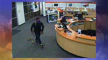 Surveillance photo from a cellphone store burglary in Chandler By Jennifer Thomas