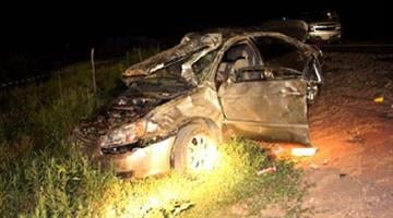 A Kia Spectra rolled over a median, through opposite lanes of traffic and into a cattle fence By Jennifer Thomas