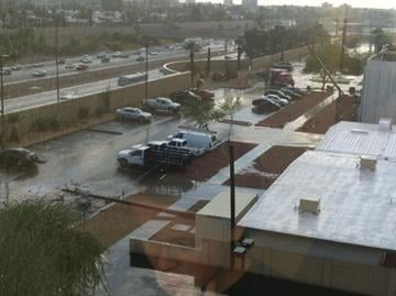 Rain falling and power poles down at Banner Good Samaritan Medical Center, McDowell Rd. & 11th St. By Mike Gertzman