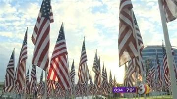 More than 200 volunteers gathered at Tempe Beach Park Sunday to plant nearly 3,000 flags -- one for each victims of the Sept. 11 terror attacks in 2001. By Catherine Holland