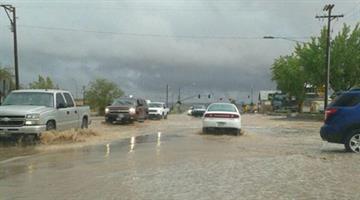 Street flooding on Main Street near the Historic Tuba City Trading Post By Jennifer Thomas