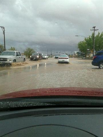 Street flooding on Main Street near the Historic Tuba City Trading Post By Jennifer Thomas