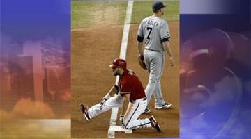 Arizona Diamondbacks' Adam Eaton slides into third base with a run-scoring triple as San Diego Padres' Chase Headley looks away in the fifth inning of a baseball game Wednesday, Sept. 19, 2012, in Phoenix. By Jennifer Thomas