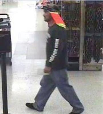 Surveillance photo of suspect who robbed a Wells Fargo bank in Scottsdale By Jennifer Thomas