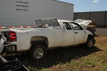 Sheriff Larry Dever was driving a white 2008 3/4-ton Chevrolet pickup truck on a dirt road near Williams when he lost control Tuesday night. By Jennifer Thomas