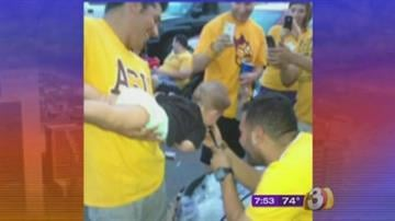 An attorney said the photo of a baby doing a keg stand at an ASU tailgate party was staged and the child was not drinking alcohol. By Jennifer Thomas