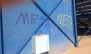 """Westwood High School in Mesa was vandalized overnight. Someone spray-painted """"MESA"""" on the football field, the ticket booth and the  area around the bleachers. By Jennifer Thomas"""