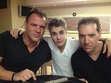 """Radio personalities Johnjay Van Es and Rich Berra with Justin Bieber before the """"Believe"""" concert on Saturday night at Jobing.com Arena in Glendale, Ariz. By Mike Gertzman"""