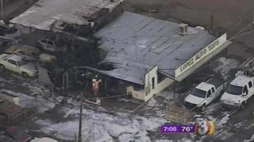 A fire started outside a building near Missouri and 27th avenues Monday morning and made its way into an auto upholstery shop. By Jennifer Thomas