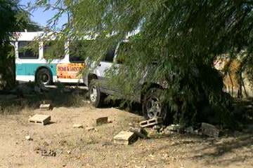 A vehicle hit the back of a bus, struck a pedestrian and crashed through a block fence in Glendale. By Jennifer Thomas