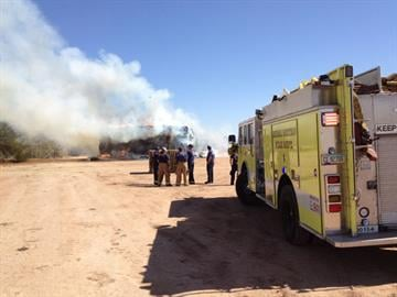 A hay fire near Warner and Hawes roads in Mesa started Monday and is expected to burn for a couple of days. By Jennifer Thomas