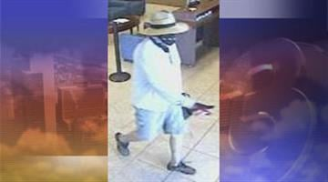 A man wearing a straw hat, a bandanna, and red and black gloves robbed the Chase Bank near Peoria and 99th avenues on Sept. 25. By Jennifer Thomas
