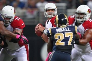 ST. LOUIS, MO - OCTOBER 4:  Kevin Kolb #4 of the Arizona Cardinals looks to pass against the St. Louis Rams at the Edward Jones Dome on October 4, 2012 in St. Louis, Missouri.  (Photo by Dilip Vishwanat/Getty Images) By Dilip Vishwanat