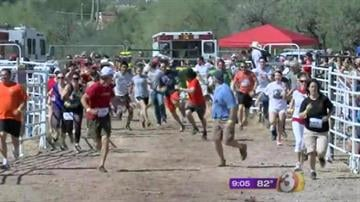 More than an estimated 700 willing runners ran for their lives Saturday in the annual running of the bulls in this small Arizona town, around an hour north of Phoenix. By Mike Gertzman