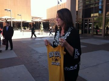 Karen Montenegro, mother of murder victim Kyleigh Sousa, holds up her daughter's ASU shirt outside of court moments after a jury found Joseluis Marquez guilty of first-degree murder in 2010 dragging death and robbery of of Sousa. By Mike Gertzman