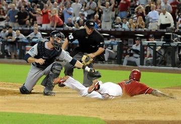 PHOENIX, AZ - JUNE 20:  Ryan Roberts #14 of the Arizona Diamondbacks slides safely into home plate ahead of a tag by John Jaso #27 of the Seattle Mariners at Chase Field on June 20, 2012 in Phoenix, Arizona.  (Photo by Norm Hall/Getty Images) By Norm Hall