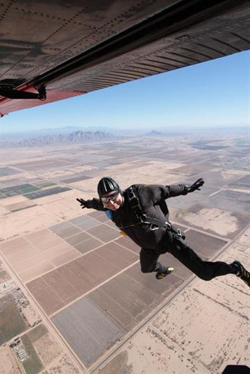 A competitor exits the aircraft during the accuracy landing event at the 2012 USPA National Skydiving Championships. By Niklas Daniel