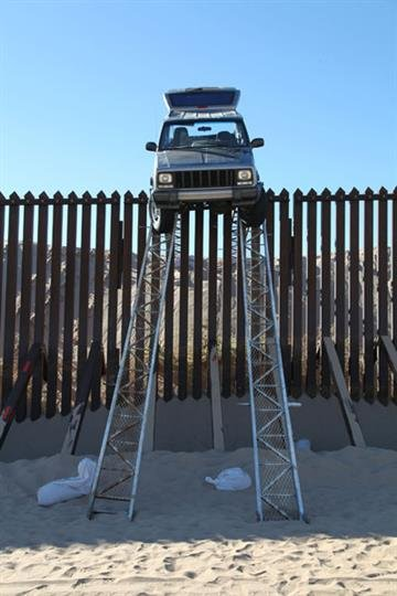 Suspected smugglers tried to drive a Jeep over a 14-foot-high border fence using a makeshift ramp. By Jennifer Thomas
