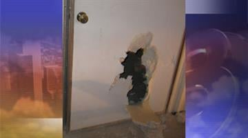 The suspects smashed open a hole in a door to gain entry into Rimrock High School. By Jennifer Thomas