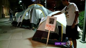 People angry with the Maricopa County Board of Supervisors over its decision to send a multi-million dollar wrongful death lawsuit back to a jury camped out in downtown Phoenix overnight in protest. By Catherine Holland