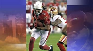 Arizona Cardinals wide receiver Larry Fitzgerald breaks breaks the tackle of San Francisco 49ers free safety Dashon Goldson during the second half of an NFL football game, Monday, Oct. 29, 2012, in Glendale, Ariz. By Jennifer Thomas