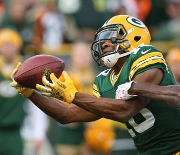 GREEN BAY, WI - NOVEMBER 04: Randall Cobb #18 of the Green Bay Packers catches a touchdown pass against the Arizona Cardinals at Lambeau Field on November 4, 2012 in Green Bay, Wisconsin. (Photo by Jonathan Daniel/Getty Images) By Jonathan Daniel