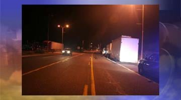 A woman was hit and killed by a commercial truck after walking into traffic on Highway 60 in Superior. By Jennifer Thomas