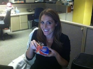 3TV anchor Christine LaCroix enjoying a Hostess Zinger that reporter Jared Dillingham shared with her. By Mike Gertzman
