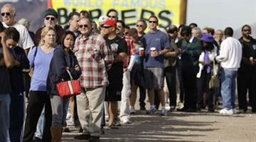 A crowd that includes residents from California and Nevada lines up for Powerball tickets outside the Arizona Last Stop convenience store in White Hills, Ariz. By Mike Gertzman