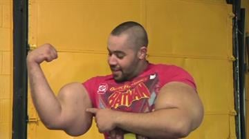 Moustafa Ismail's upper arms are as big as many people's waists. The Massachusetts resident has eye-popping biceps and triceps, and his upper arms measure 31 inches around! By Tami Hoey