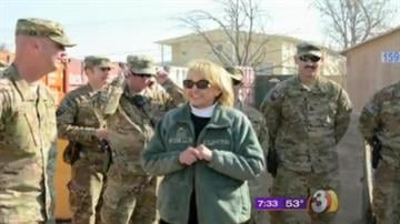 Gov. Jan Brewer made an unannounced trip to military bases in Afghanistan this week as she visited with service members from Arizona and flew around the war-torn nation in helicopters with guns hanging out the windows. By Catherine Holland