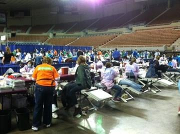 Free dental clinic set up on the floor of the Coliseum By Tami Hoey