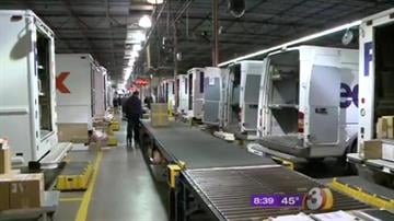 It's the busiest shipping day of the year for FedEx as some 30,000 workers throughout the country pitch in to lend Santa a hand. By Catherine Holland