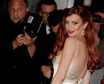 "BEVERLY HILLS, CA - NOVEMBER 20:  Actress Lindsay Lohan arrives at a party to celebrate Lifetime's ""Liz & Dick"" at the Beverly Hills Hotel on November 20, 2012 in Beverly Hills, California.  (Photo by Kevin Winter/Getty Images) By Kevin Winter"