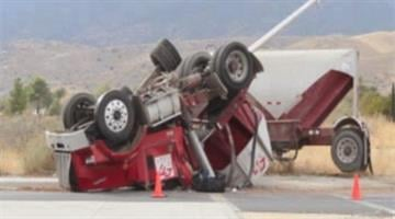 A dump truck rolled over on Highway 89 after hitting a car Thursday afternoon. By Jennifer Thomas