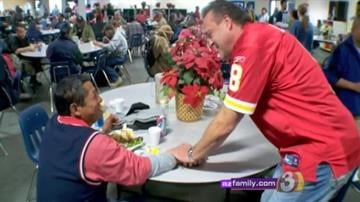 Hundreds of local families packed St. Vincent de Paul's Phoenix shelter this Christmas Day. By Catherine Holland