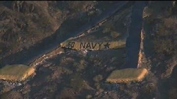 "Navy Midshipmen fans made a statement about Saturday's Kraft Fight Hunger Bowl by painting the A on A Mountain Navy blue. Aerial video clearly showed their message -- ""Go Navy."" By Catherine Holland"