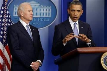President Barack Obama and Vice President Joe Biden make a statement regarding the passage of the fiscal cliff bill in the Brady Press Briefing Room at the White House in Washington, Tuesday, Jan. 1, 2013. (AP Photo/Charles Dharapak) By Charles Dharapak