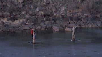 Two teenagers were rescued after spending two frigid hours hanging onto a dead tree after ice on Fool Hollow Lake began to crack. By Jennifer Thomas