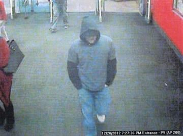 Surveillance photo of a person of interest in the attempted robbery of the Bank of America at 48th Street and Ray Road in Phoenix on Dec. 29. This picture was taken inside a nearby Target store at approximately 7:30 p.m. on Dec. 20. By Jennifer Thomas