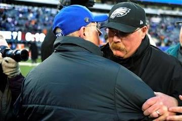 Philadelphia Eagles head coach Andy Reid, right, shakes hands with New York Giants head coach Tom Coughlin after an NFL football game, Sunday, Dec. 30, 2012, in East Rutherford, N.J. The Giants won 42-7. (AP Photo/Bill Kostroun) By Bill Kostroun