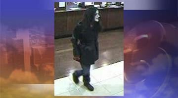 Surveillance photo of suspect By Jennifer Thomas