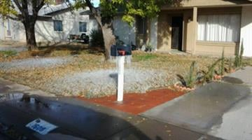Water from sprinklers left behind some ice at this home in North Phoenix By Mike Gertzman