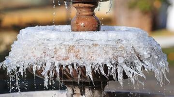 Frozen fountain in Glendale, Ariz. By Mike Gertzman