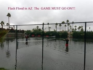 A soggy game of tennis at Goodlife RV Resort. By Andrew Michalscheck