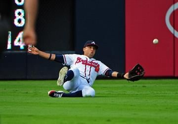 ATLANTA, GA - AUGUST 13: Martin Prado #14 of the Atlanta Braves makes a sliding catch to end the first inning against the San Diego Padres at Turner Field on August 13, 2012 in Atlanta, Georgia. (Photo by Scott Cunningham/Getty Images) By Scott Cunningham